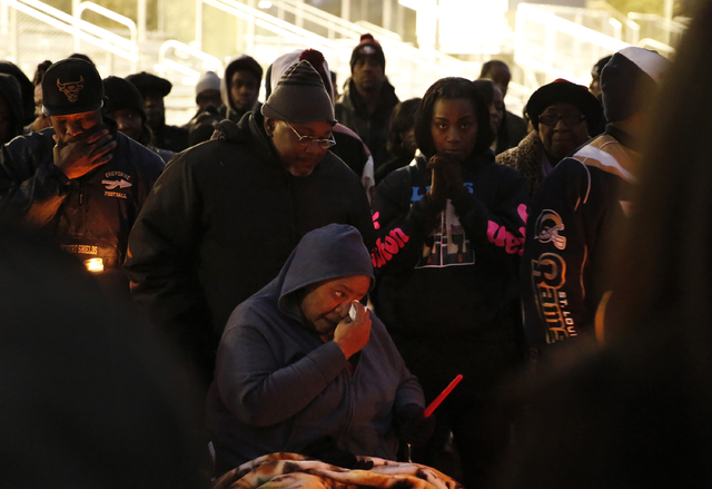 Stephanie Weatherspoon, center, and her husband, Michael, mourn at a vigil for Jesse Lee Swan at Dr. William U. Pearson Community Center, Dec. 24, 2016 in North Las Vegas. Stephanie is the stepmot ...