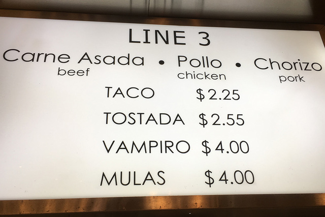 Signs show some of the meats and styles of food at Taco Y Taco's location near Henderson. BRIAN SANDFORD/VIEW