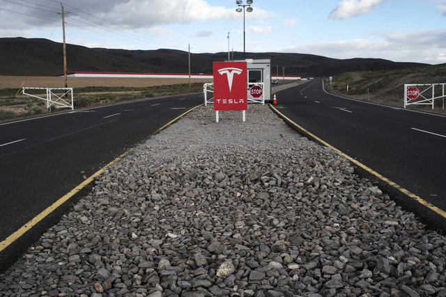 The Tesla Motors logo on a sign at the entrance to the company's Gigafactory in McCarran, Nevada, on April 25, 2016. (David Paul Morris/Bloomberg)