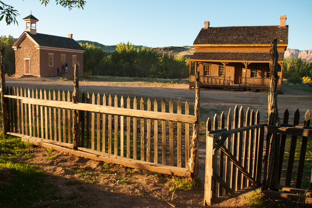 Grafton Ghost Town at Dusk near Rockville Utah showing the old Schoolhouse and Russell House from behind a picket fence. (Thinkstock)