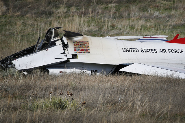 A U.S. Air Force Thunderbird rests in a field where it crashed following a flyover performance at a commencement for Air Force Academy cadets, south of Colorado Springs, Colo.,  Thursday, June 2,  ...
