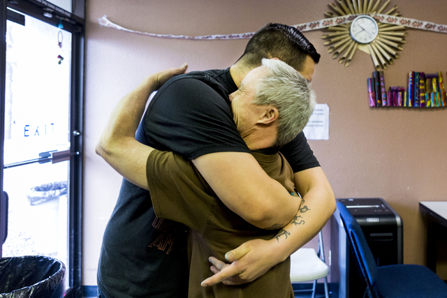 Juan Jimenez, community training specialist, left, and Jeff Rodgers, an individual at Transition Services facility, hug at the facility in Henderson, Thursday, Dec. 15, 2016. (Elizabeth Page Bruml ...