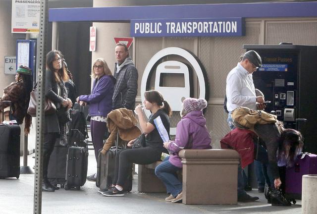 Arriving passengers wait for an RTC bus at Terminal One at McCarran International Airport Wednesday, Dec. 14, 2016, in Las Vegas. (Bizuayehu Tesfaye/Las Vegas Review-Journal)@bizutesfaye