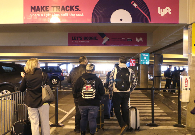 Arriving passengers at McCarran Airport wait for their ride at Ride Share pick up area  Wednesday, Dec. 14, 2016, in Las Vegas. (Bizuayehu Tesfaye/Las Vegas Review-Journal)@bizutesfaye