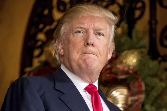 President-elect Donald Trump takes a question from a member of the media at Mar-a-Lago, in Palm Beach, Fla., Wednesday, Dec. 21, 2016.   Trump on Thursday abruptly called for the United States to  ...