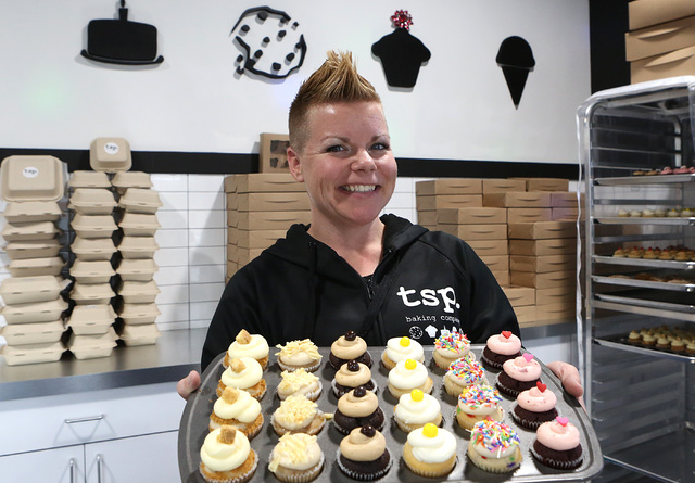 TSP Baking owner Kari Garcia holds assorted mini-cupcakes at her store on 6120 N. Decatur Blvd. on Thursday, Dec. 22, 2016, in Las Vegas. (Bizuayehu Tesfaye/Las Vegas Review-Journal)@bizutesfaye