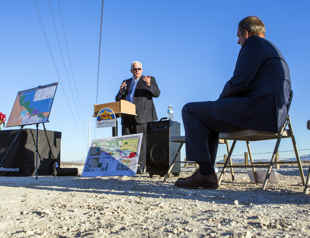 Brian Ragsdale, left, with KBS Capital Advisors speaks while North Las Vegas Mayor John Lee listens during a news conference announcing a deal to create the first trail at Tule Springs Fossil Beds ...
