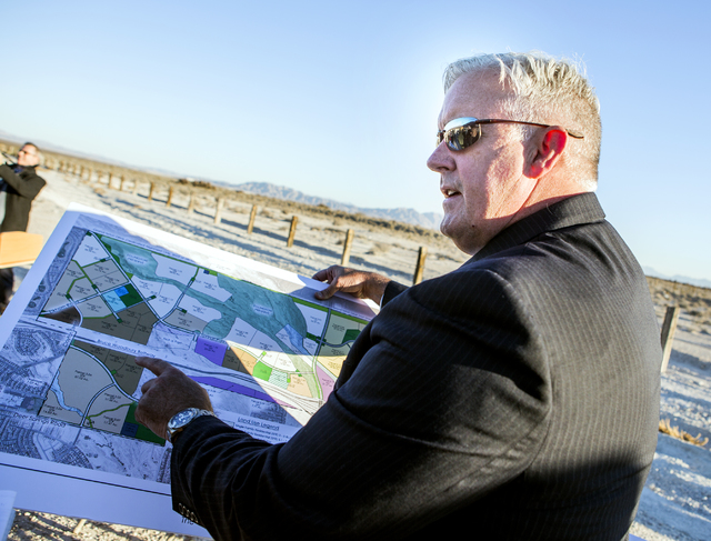 Brian Ragsdale with KBS Capital Advisors holds a map showing the The Villages at Tule Springs during a news conference announcing a deal to create the first trail at Tule Springs Fossil Beds Natio ...