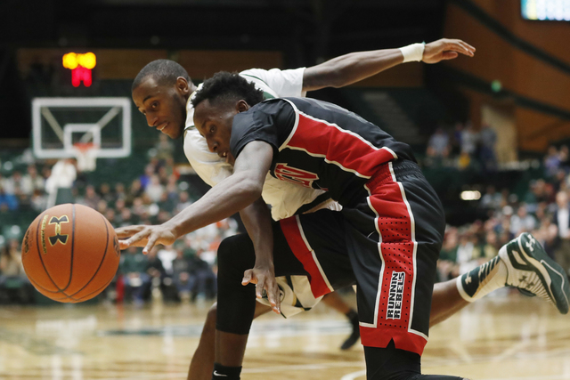 UNLV guard Kris Clyburn, front, fights for control of a loose ball with Colorado State guard J.D. Paige in the second half of an NCAA college basketball game Wednesday, Dec. 28, 2016, in Fort Coll ...