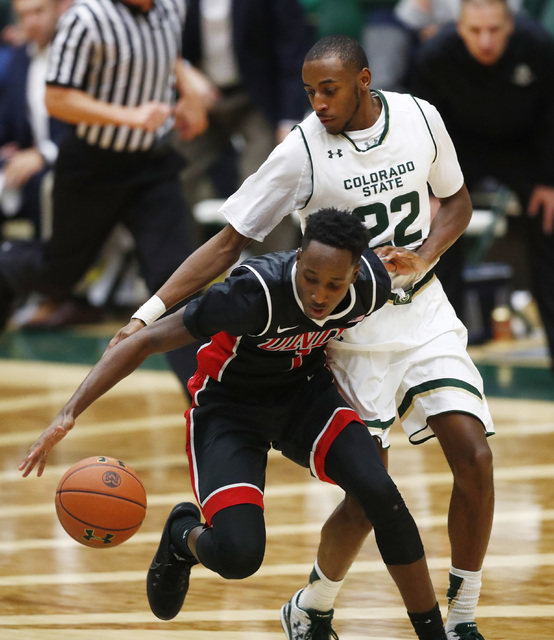 UNLV guard Kris Clyburn, front, loses control of the ball as Colorado State guard J.D. Paige defends during the second half of an NCAA college basketball game Wednesday, Dec. 28, 2016, in Fort Col ...