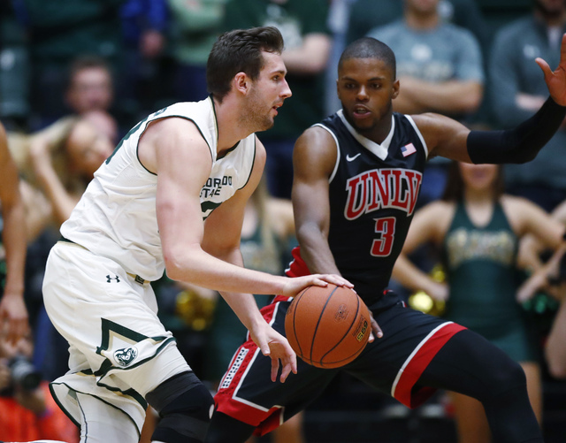 Colorado State forward Braden Koelliker, left, drives to the basket as UNLV forward Tyrell Green defends during the second half of an NCAA college basketball game Wednesday, Dec. 28, 2016, in Fort ...