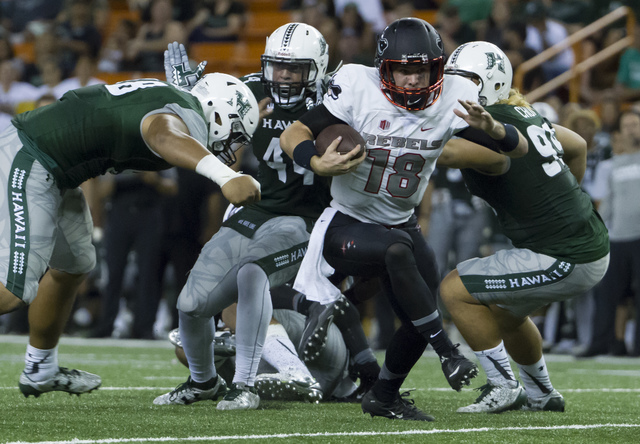 UNLV quarterback Dalton Sneed (18) breaks free of the Hawaii defense and runs with the football in the third quarter of an NCAA college football game, Saturday, Oct. 15, 2016, in Honolulu. (Eugene ...