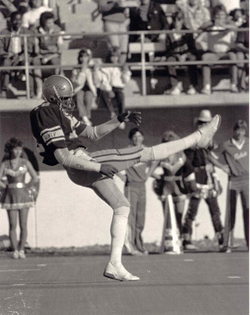 UNLV Rebels quarterback/punter Randall Cunningham (12) punts during a game at Sam Boyd Stadium in Las Vegas in this undated file photo. Cunningham played at UNLV 1982-84 and was drafted in the 2nd ...