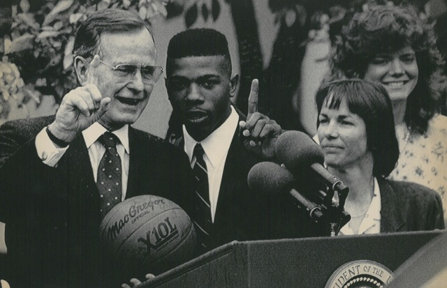President Bush welcomes the UNLV Runnin' Rebels and Stanford Cardinal, NCAA men and women's basketball champions, to the White House. Greg Anthony (middle) stands with President Bush (left) and St ...