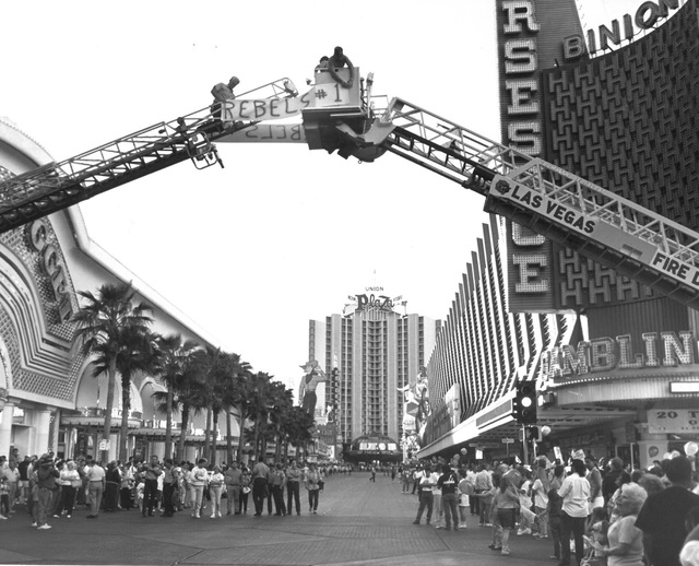 Firefighters erected their ladders to display their appreciation for the Rebels. (James Kenney/Las Vegas Review-Journal)