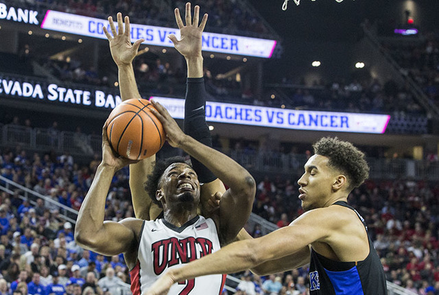UNLV's Uche Ofoegbu (2) drives past Duke's Chase Jeter (2) during the Rebels home matchup with the Blue Devils at T-Mobile Arena on Saturday, Dec. 10, 2016, in Las Vegas. (Benjamin Hager/Las Vegas ...