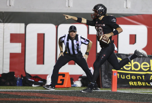 UNLV quarterback Dalton Sneed (18) scores a touchdown against Fresno State during a football game at Sam Boyd Stadium in Las Vegas on Saturday, Oct. 1, 2016. (Chase Stevens/Las Vegas Review-Journa ...
