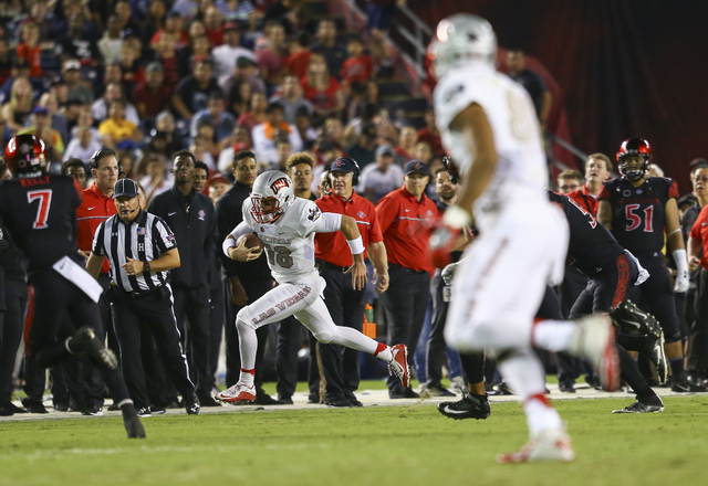 UNLV quarterback Dalton Sneed (18) runs the ball during a football game against San Diego State at Qualcomm Stadium in San Diego on Saturday, Oct. 8, 2016. (Chase Stevens/Las Vegas Review-Journal) ...