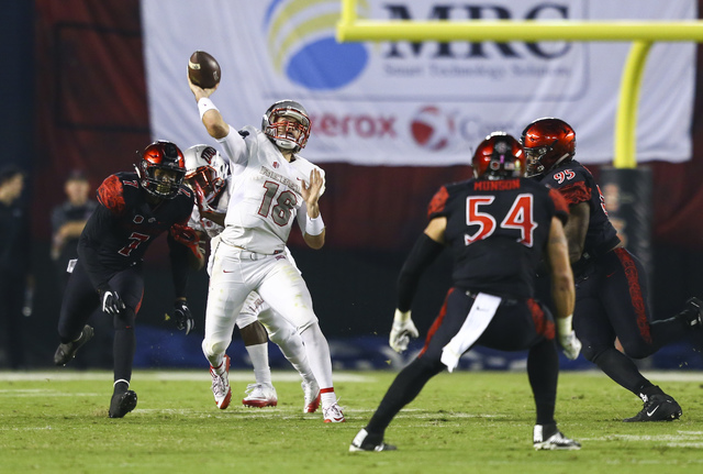 UNLV quarterback Dalton Sneed (18) makes a pass during a football game against San Diego State at Qualcomm Stadium in San Diego on Saturday, Oct. 8, 2016. San Diego State won 26-7 over the Rebels. ...
