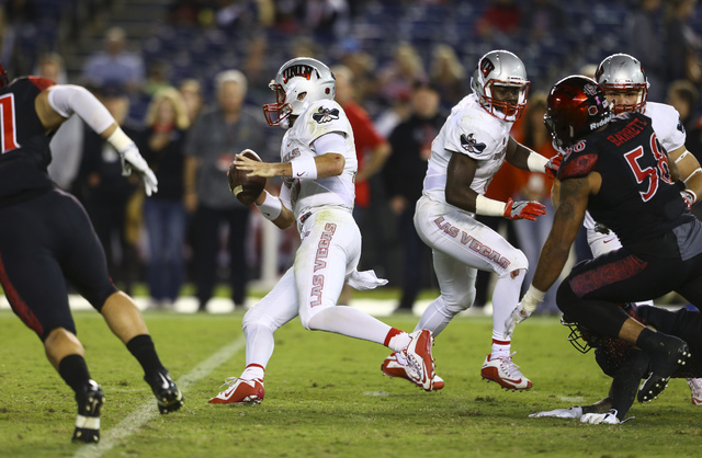 UNLV quarterback Dalton Sneed (18) runs the ball against San Diego State during a football game at Qualcomm Stadium in San Diego on Saturday, Oct. 8, 2016. San Diego State won 26-7 over the Rebels ...