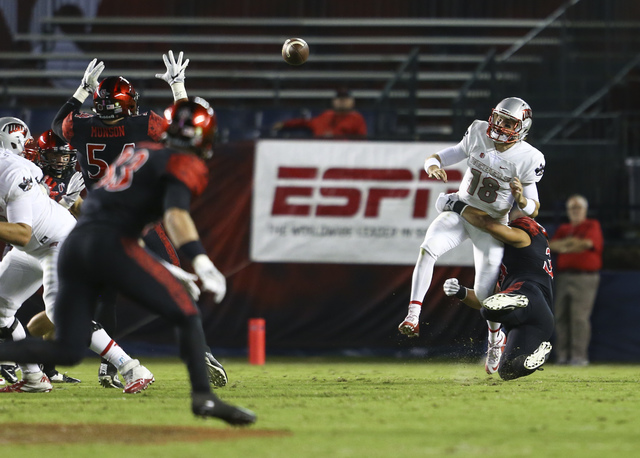 UNLV quarterback Dalton Sneed (18) makes an incomplete pass during a football game against San Diego State at Qualcomm Stadium in San Diego on Saturday, Oct. 8, 2016. San Diego State won 26-7 over ...