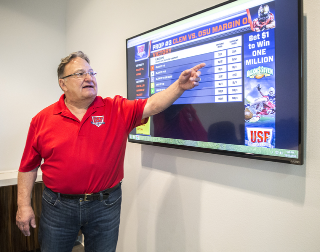 US Fantasy president Vic Salerno explains the function of a video display board showing current betting odds on Thursday, Dec. 15, 2016, at US Fantasy, in Las Vegas. (Benjamin Hager/Las Vegas Revi ...