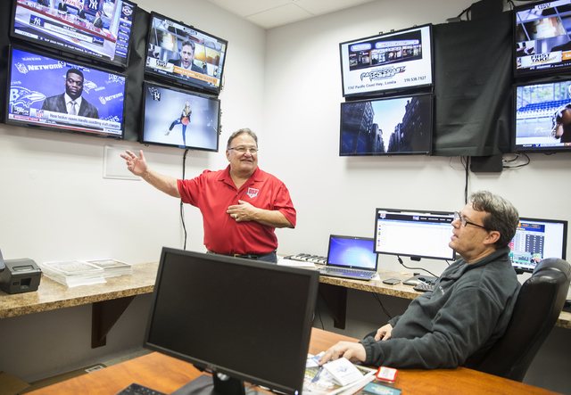 """US Fantasy president Vic Salerno, left, discusses betting odds with strategic planner Robert Walker in the """"war room"""" on Thursday, Dec. 15, 2016, at US Fantasy, in Las Vegas. (Be ..."""