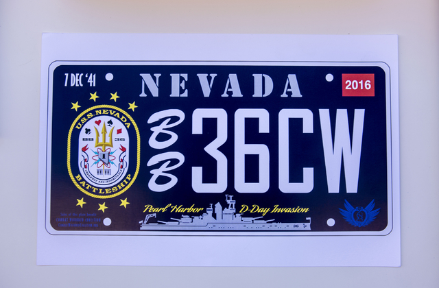 A mock up of a Nevada license plate in honor of the U.S.S. Nevada (BB-36) battleship designed John Galloway, pilot and U.S.S. Nevada historian, pictured at the Las Vegas Review-Journal, Wednesday, ...