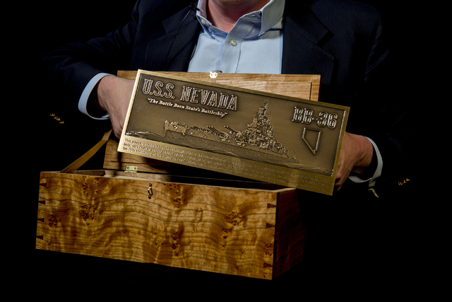John Galloway, pilot and U.S.S. Nevada historian, holds a plaque that will be displayed in Pearl Harbor in honor of the U.S.S. Nevada (BB-36) battleship, pictured at the Las Vegas Review-Journal W ...