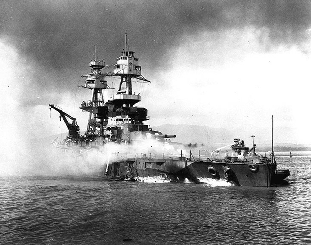 HISTORIC -- The USS Nevada (BB-36) gets doused on its port side by the harbor tug Hoga in the shallows of Pearl Harbor on Sunday, Dec. 7, 1941. The battleship was intentionally beached after surpr ...