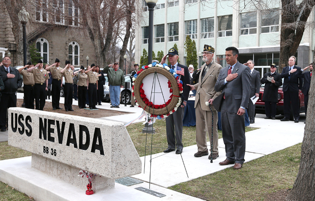 From left center, Bud Southard, president of the Navy League, veteran Charles Sehe and Gov. Brian Sandoval lay a wreath at the state memorial during the USS Nevada Centennial Ceremony at the Capit ...