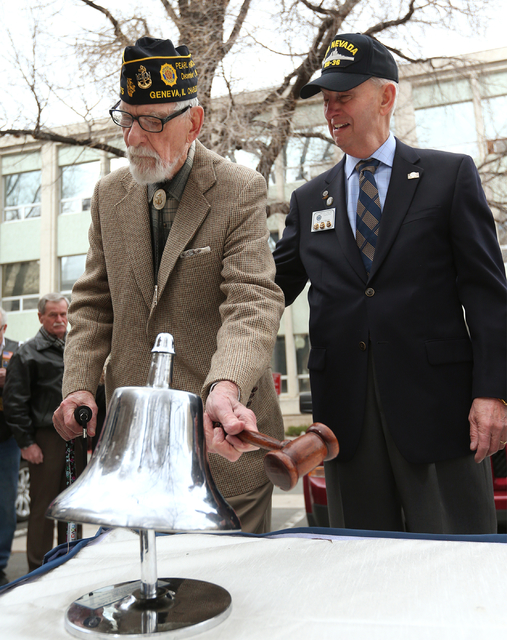 Pearl Harbor survivor Charles Sehe, left, rings the USS Nevada shipճ bell in honor of his shipmates who died at Pearl Harbor during the USS Nevada Centennial Ceremony at the Capitol in Carso ...