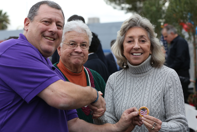 Publisher and editor of National Veterans Magazine, Mark Field, left, greets Councilman Bob Coffin and Rep. Dina Titus at the opening ceremony and ribbon cutting for the second Veterans Village in ...