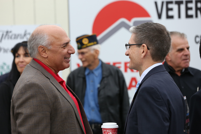 Councilman Stavros S. Anthony, left, and Rep. Joe Heck chat during the grand opening and ribbon cutting ceremony for the second Veterans Village in downtown Las Vegas on Thursday, Dec.15, 2016. (M ...
