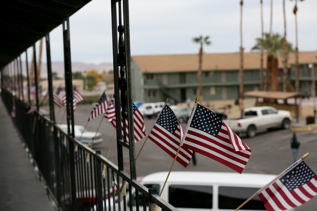 Flags decorate the railing of another 204 units of housing at Veterans Village second location which includes a crisis intervention center and a food pantry for homeless veterans in downtown Las V ...
