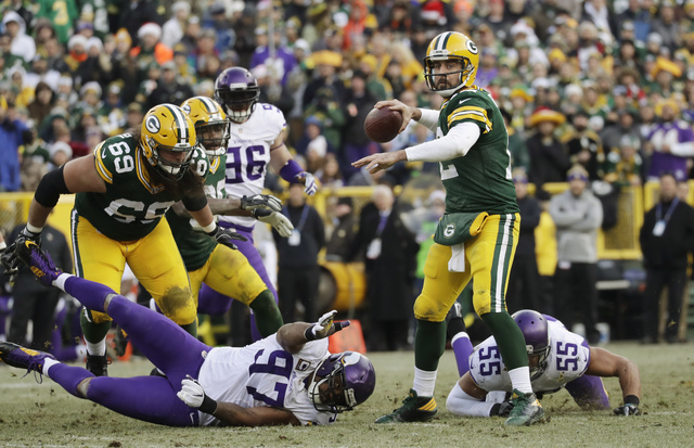 Green Bay Packers' Aaron Rodgers throws during the second half of an NFL football game against the Minnesota Vikings Saturday, Dec. 24, 2016, in Green Bay, Wis. (AP Photo/Morry Gash)