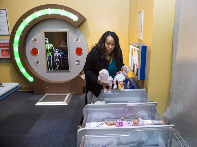 Tifferney White, CEO and president of Discovery Children's Museum, 360 Promenade Place, holds dolls in the new Sunrise Children's Museum exhibit at Eco City on Friday, Dec. 16, 2016. Jeff Scheid/L ...