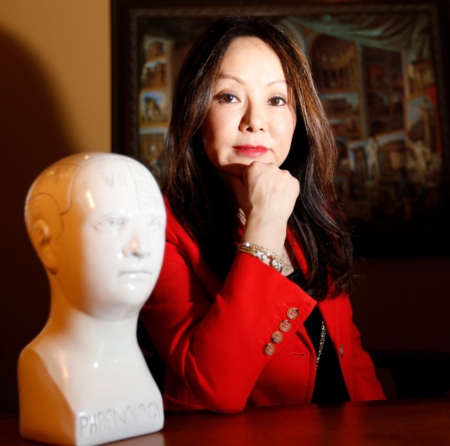Dr. Kate Zhong, a geriatric psychiatrist and pharmacologist, poses for a photo in her home office in Henderson, Monday, Nov. 28, 2016. Chitose Suzuki/Las Vegas Review-Journal