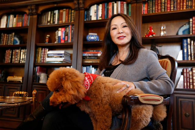 Dr. Kate Zhong, a geriatric psychiatrist and pharmacologist, poses for a photo with her dog Teddy in her home office in Henderson, Monday, Nov. 28, 2016. Chitose Suzuki/Las Vegas Review-Journal