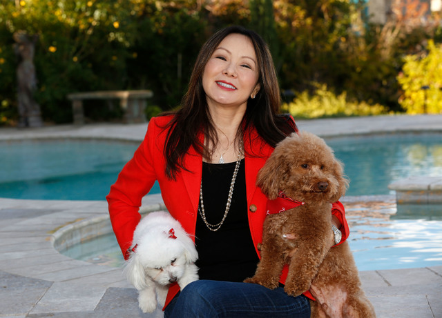Dr. Kate Zhong, a geriatric psychiatrist and pharmacologist, poses for a photo with her dogs Ella, left, and Teddy in her home in Henderson, Monday, Nov. 28, 2016. Chitose Suzuki/Las Vegas Review- ...