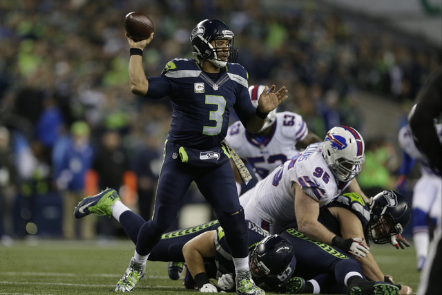 Seattle Seahawks quarterback Russell Wilson passes against the Buffalo Bills in the second half of an NFL football game, Monday, Nov. 7, 2016, in Seattle. (John Froschauer/AP)