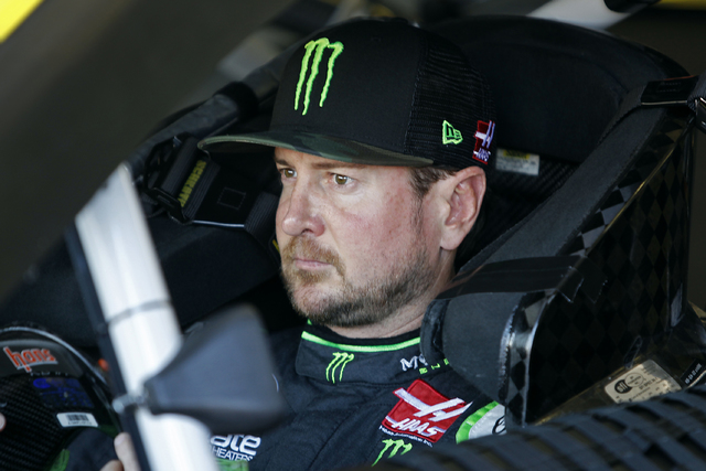 Kurt Busch sits in his race car before practice for the NASCAR Sprint Cup Series auto race at Phoenix International Raceway, Saturday, Nov. 12, 2016, in Avondale, Ariz. (AP Photo/Ralph Freso)