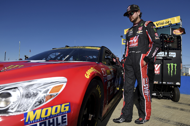 Kurt Busch stands by his car during qualifying for Sunday's NASCAR Sprint Cup auto race at Talladega Superspeedway on Saturday, Oct. 22, 2016, in Talladega, Ala. (Rainier Ehrhardt/AP)