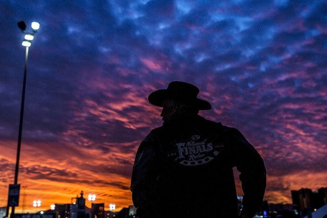 Robert Nelson waits outside the Thomas & Mack Center at dusk before the start of the National Finals Rodeo on Monday, Dec. 5, 2016, in Las Vegas. (Benjamin Hager/Las Vegas Review-Journal)