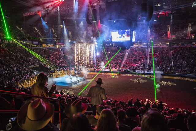 A laser show signals the start of the fifth day of the National Finals Rodeo at the Thomas & Mack Center on Monday, Dec. 5, 2016, in Las Vegas. (Benjamin Hager/Las Vegas Review-Journal)