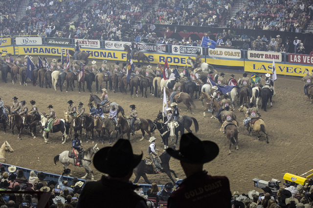 The opening ceremony begins on the sixth day of the National Finals Rodeo at the Thomas & Mack Center on Tuesday, Dec. 6, 2016, in Las Vegas. (Benjamin Hager/Las Vegas Review-Journal)
