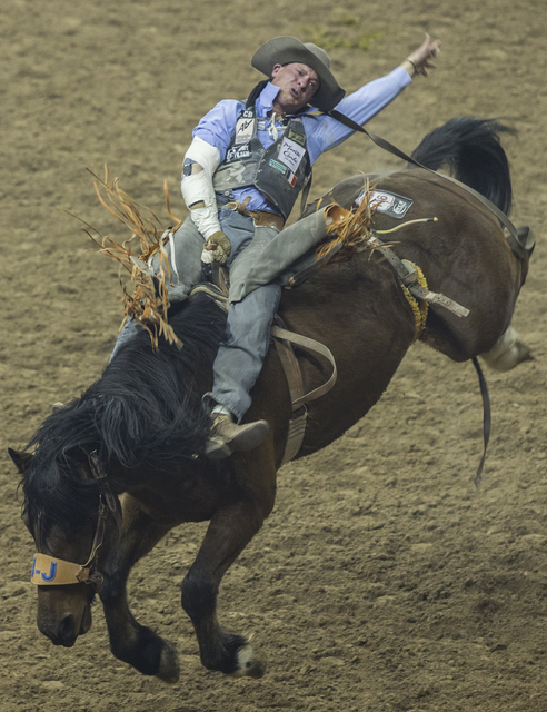 J.R. Vezain rides Happy Trails during the bareback riding competition at the National Finals Rodeo at the Thomas & Mack Center on Tuesday, Dec. 6, 2016, in Las Vegas. Benjamin Hager/Las Vegas  ...