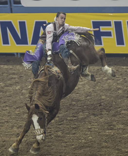 Jake Brown rides Starbust during the bareback riding competition at the National Finals Rodeo at the Thomas & Mack Center on Tuesday, Dec. 6, 2016, in Las Vegas. Benjamin Hager/Las Vegas Revie ...