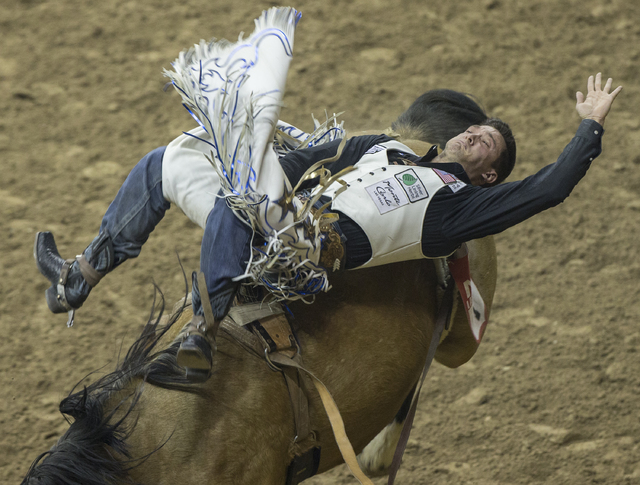 Caleb Bennett rides Garden Party during the bareback riding competition at the National Finals Rodeo at the Thomas & Mack Center on Tuesday, Dec. 6, 2016, in Las Vegas. Benjamin Hager/Las Vega ...