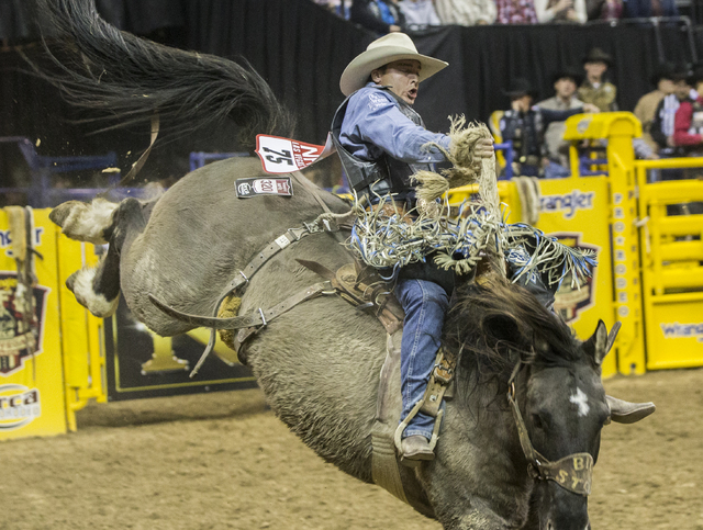 Jesse Wright rides Big Muddy during the saddle bronc competition at the National Finals Rodeo at the Thomas & Mack Center on Tuesday, Dec. 6, 2016, in Las Vegas. Benjamin Hager/Las Vegas Revie ...